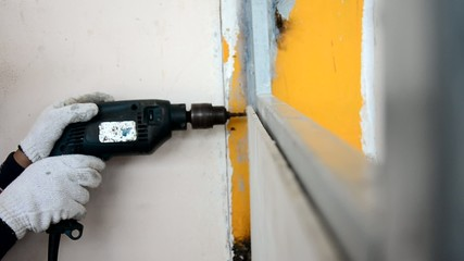 Man use drilling machine drill screw