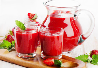 Strawberry fresh  smoothie with  berries on a wooden background
