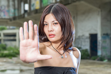 Chinese woman gesturing no with hand