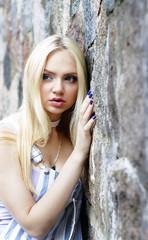 young girl at a wall