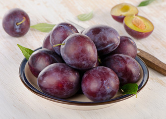 Plums on a  wooden background