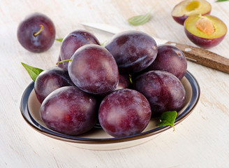 Sweet Plums on a  wooden table