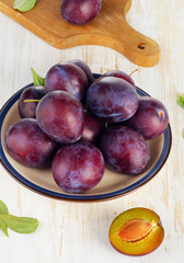 Fresh Plums on a  wooden table