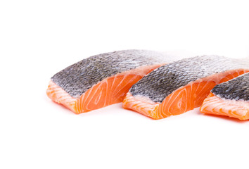 Fresh red salmon fillet slices.