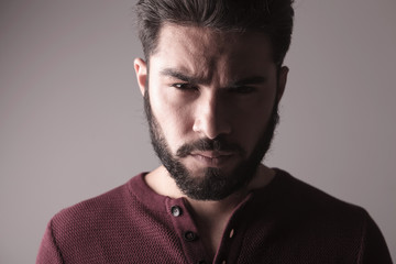 man wearing a sweater and looking at the camera