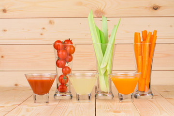Fresh vegetables juices in glasses.