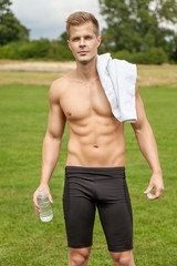Muscular young man with a water bottle