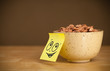 Post-it note with smiley face sticked on cereal bowl