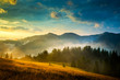 Amazing mountain landscape with fog and a haystack - 70799113