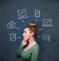 Young woman thinking with drawn gadgets around her head
