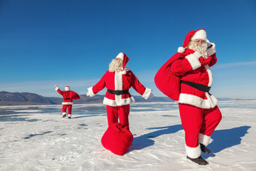 Three  Santa Claus outdoors, multiexposition