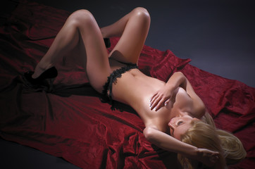 Stunning blond girl in act art photo session