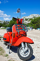 vintage red scooter ready for the journey