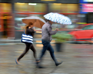 People walking down the street on a rainy day