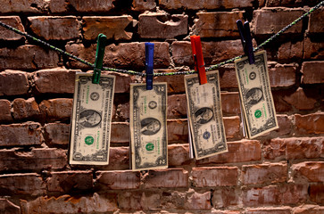 Dollar bills hanging on rope