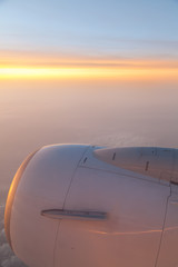Airplane engine with sunrise in the horizon