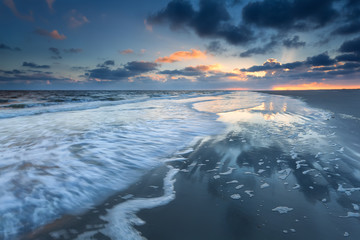 sunrise over North sea coast during low tide