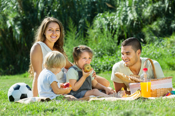 parents with daughters having picnic