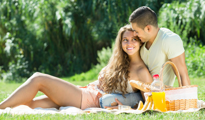 Romantic couple having picnic