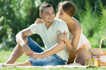 Young man and girlfriend having picnic