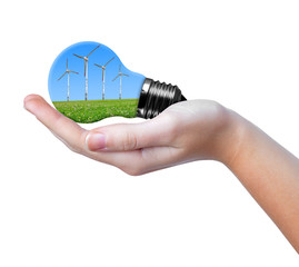 Eco bulb with wind turbines in hand isolated on white
