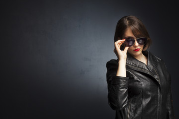 Portrait of a seductive woman on grey background.