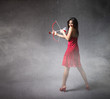 girl in red whit bow and arrows