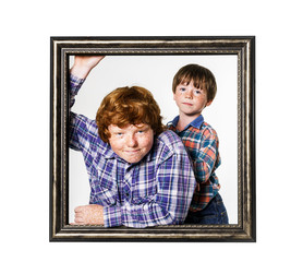 Two brothers posing with picture frame