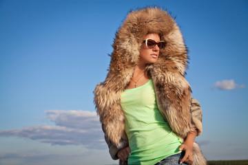 Winter Woman in Fur Coat. A photo of beautiful girl is in fur cl