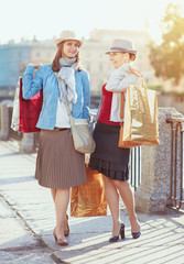 Two beautiful girls with shopping bags