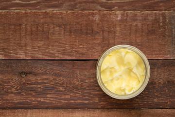 open glass jar of ghee