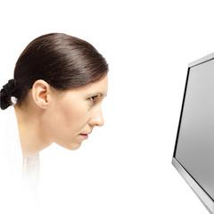 Woman staring at a computer monitor