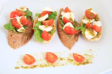 tapas with mozzarella and  cherry tomatoes