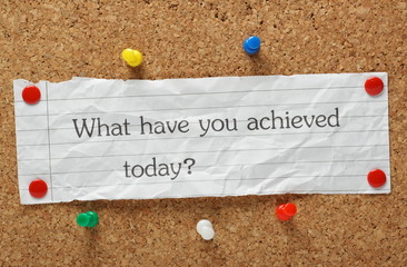 What have you achieved today reminder on a cork notice board