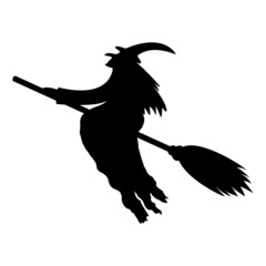 silhouette of a witch on a broomstick on Halloween