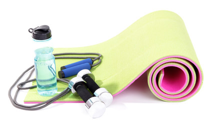Sports requisites on sport mat isolated on white