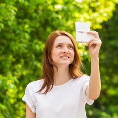 Young girl taking a selfie photo with beautiful bokeh