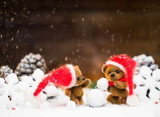 Small toy bears making snowman in christmas still life