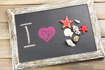 I love sea written on chalkboard, close-up