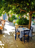 Under tree cafe tables on the village square, Vourliotes, Samos,