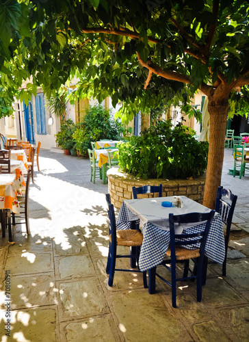 Under tree cafe tables on the village square, Vourliotes, Samos, - 70808911