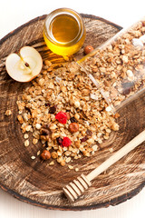 Homemade granola with nuts, dried fruit and honey