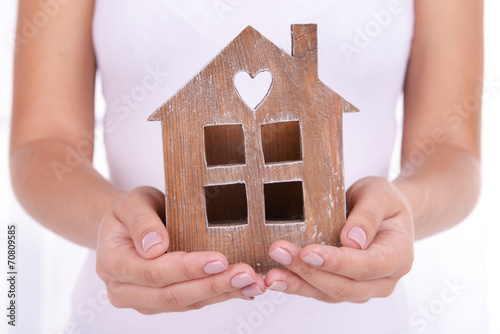 canvas print picture Woman hands holding small house close up