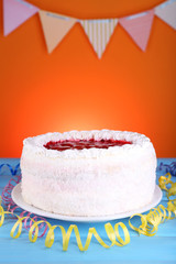 Cake on orange background