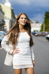 Young beautiful woman in white dress