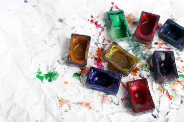 Watercolor paint cubes and spilled paint