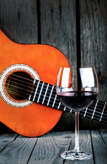 Wine and Guitar on a wooden table vintage retro photo