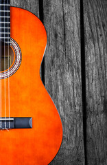 spanish Guitar on wood background