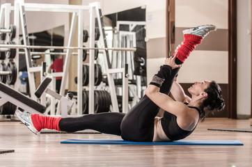 Woman showing Pilates exercises