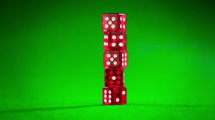 red dices on green cloth...